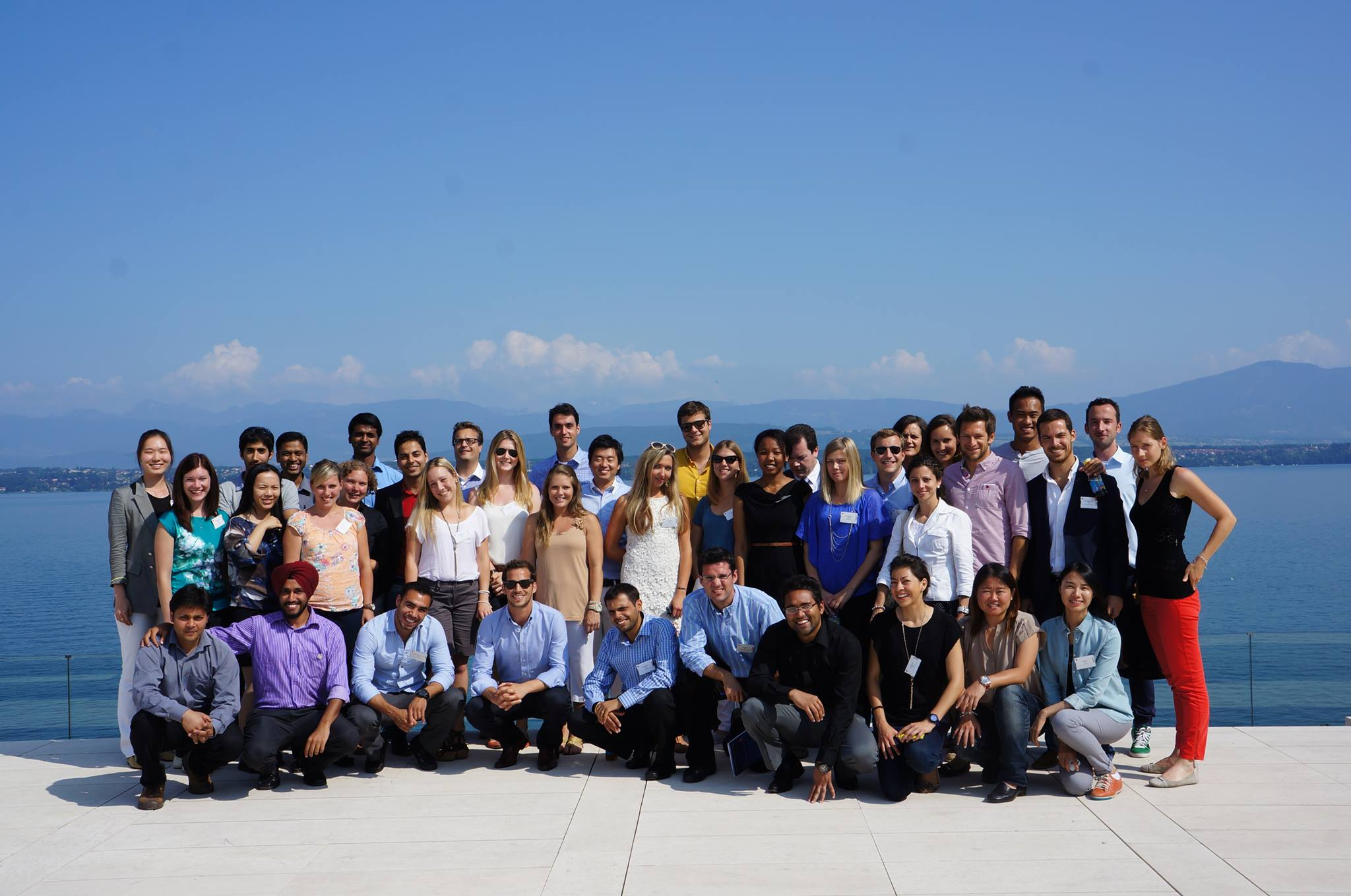 The AISTS MSA class of 2013 pose on the roof of the UEFA building in front of Lake Geneva © AISTS