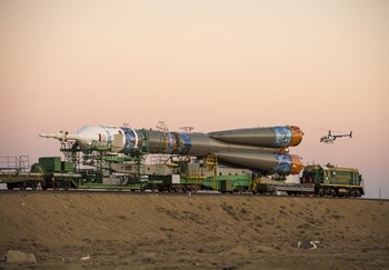 The rocket emblazed with the emblem of the Winter Olympics will carry the Olympic Torch into space on Thursday