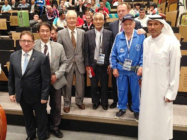 IJF Veterans Commission chairman Andrei Condor (left), Nasser Al Tamimi IJF general treasurer (right) and IJF President Marius Vizer (back row right) join some of the veterans in Abu Dhabi © IJF