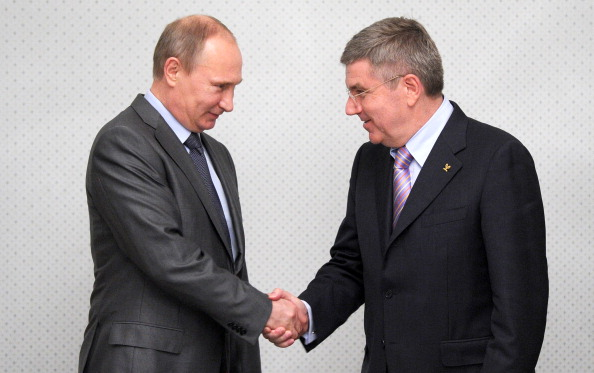 Vladimir Putin has promised Thomas Bach that athletes and officials at Sochi 2014 will be welcome regardless of their race or sexual orientation