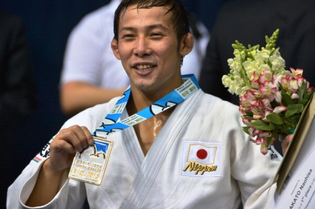 World champion Naohisa Takato will be hoping to be still smiling after the Grand Slam in Tokyo © AFP / Getty Images
