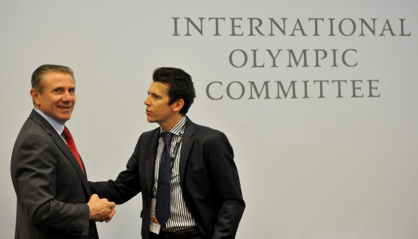 Kit McConnell take over as IOC sports director from Christophe Dubi (right), who will become the new Executive Director for the Olympic Games ©Getty Images