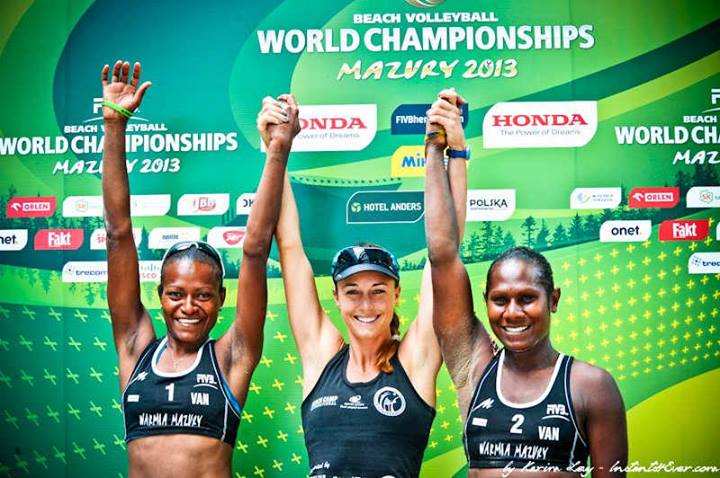 Lauren McLeod, flanked by Miller Elwin (left) and Henriette Iatika, celebrate their achievement at this year's World Beach Volleyball Championship in Poland, where they finished ninth