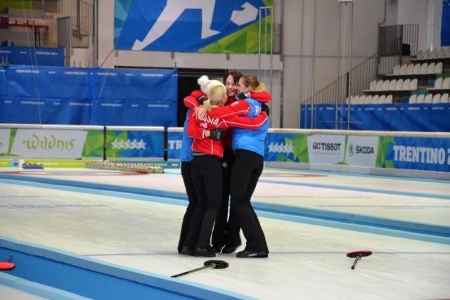 A jubilant Russian side celebrate winning the women's curling final at Trentino 2013 ©Elena Bazzanella/Trentino 2013 Universiade