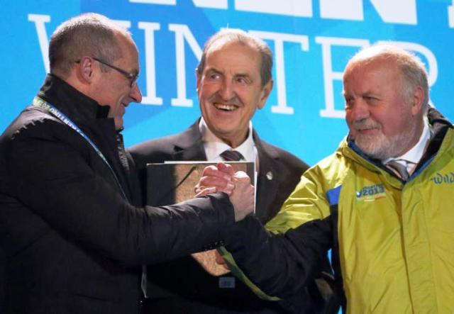 FISU President Claude-Louis Gallien (centre) has been happy with the job done by Trentino 2013 under the lead of President Sergio Anesi (right) ©Daniele Mosna/Trentino 2013 Universiade