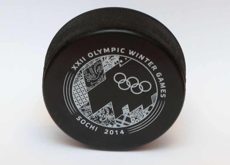 One side of the official Sochi 2014 ice hockey pucks features a coloured design, while the reverse is black and white ©Sochi 2014