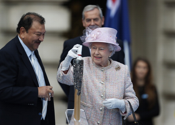 Prince Tunku Imran with Queen Elizabeth at the lighting Ceremony for the Queens Baton Relay earlier this year...he faces a battle to save his IOC membership ©Getty Images