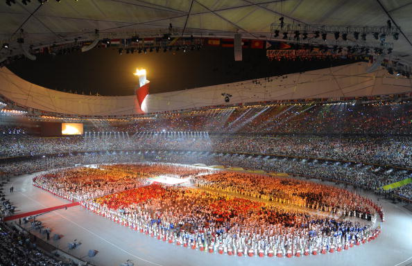 """The Olympic Flame is lit in the """"Bird's Nest"""" Stadium during Beijing 2008 ©Bob Thomas/Getty Images"""