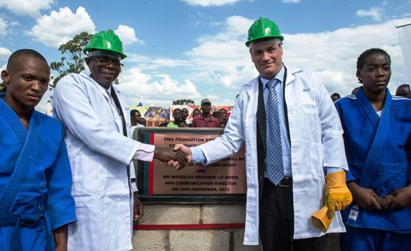 Zambian Deputy Minisiter for Youth and Sport Christopher Mulenga (left) and IJF media and communications director Nicolas Messner lay the first stone of the new national judo training centre in Lusaka ©IJF