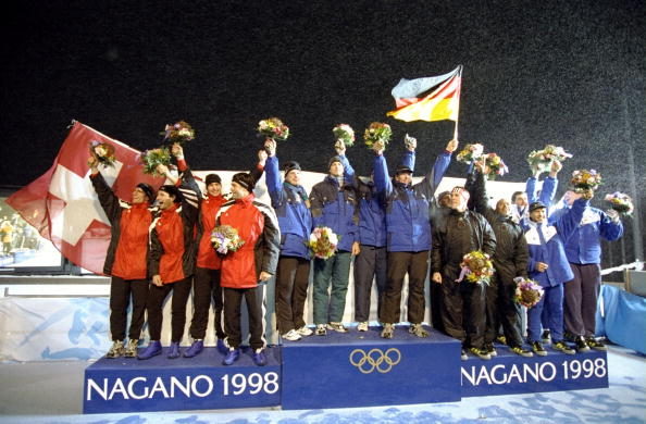 France's four-man bob team, coached by Ivo Ferriani, share the bronze medal podium position with Britain at the Nagano 1998 Games, alongside gold medallists Germany and silver medallists Switzerland ©Getty Images