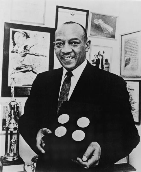 Jesse Owens smiles as he poses with the four gold medals he won at the 1936 Berlin Olympics ©Hulton Archive/Getty Images