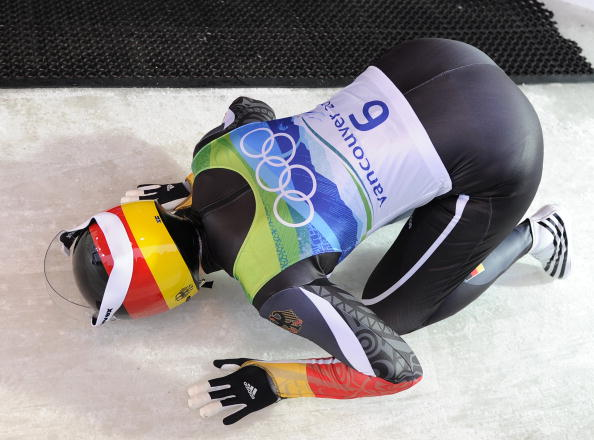 Tatjana Hüfner kisses the Whistler track after winning Olympic gold in the luge at Vancouver 2010 ©Getty Images