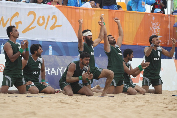 Pakistan celebrate after winning a handball bronze medal at the 2012 Beach Games in Haiyang ©Getty Images