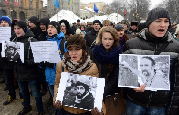 Ukrainian protesters in Lviv carry pictures of the two killed in clashes with riot police on Wednesday ©Getty Images
