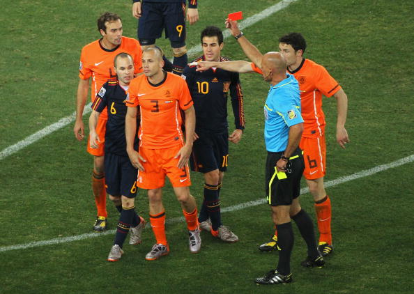 Howard Webb shows John Heitinga of the Netherlands a red card following his second bookable offence during the 2010 FIFA World Cup in South Africa ©Getty Images