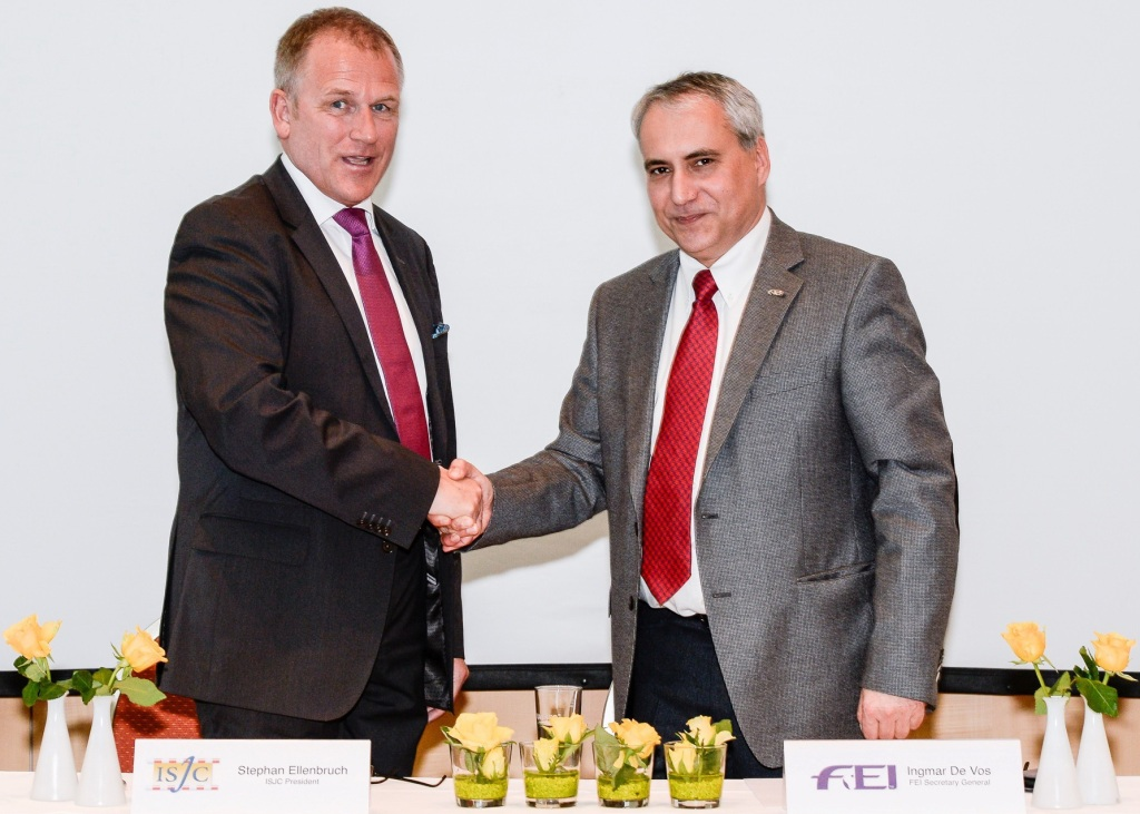 Stephan Ellenbruch and Ingmar De Vos celebrate the signing of the ISJC's Memorandum of Understanding with the FEI ©Carlo Stuppia/FEI