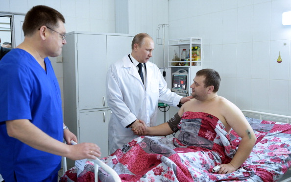 Vladimir Putin has visited victims affected by the two suicide bomb attacks in Volgograd ©AFP/Getty Images