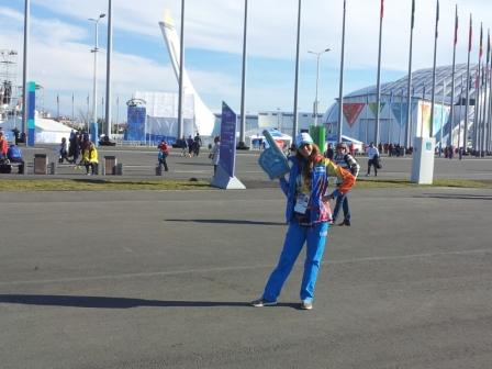 A volunteer helpfully points out the Olympic Flame for those who missed it ©ITG