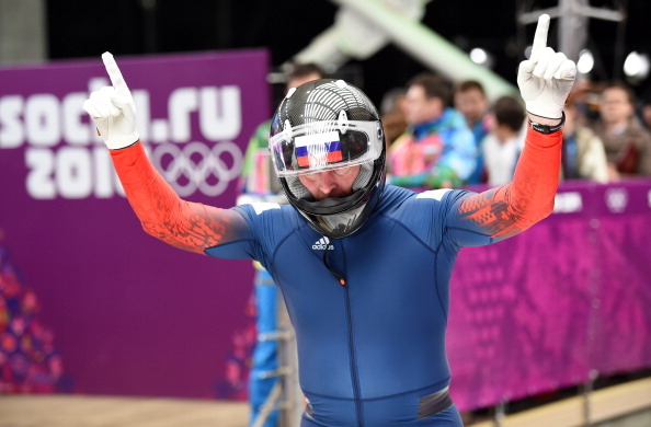 Alexander Zubkov celebrates as Russia stay on course for another sliding victory ©AFP/Getty Images