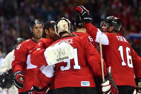 Canada celebrate after their overtime ice hockey victory over Finland ©Getty Images