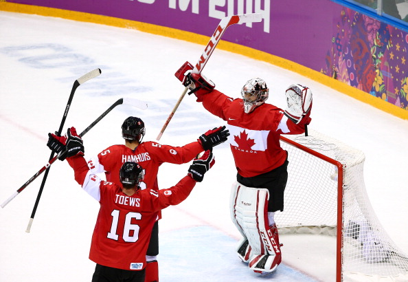 Canada players celebrate after beating Sweden to secure a historic title defence ©Getty Images