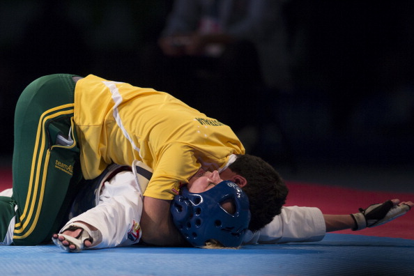Australia's Carmen Marton celebrates with her coach after winning the womens under 62 kg final  of the 2013 WTF World Taekwondo Championships in Puebla, Mexico ©Getty Images