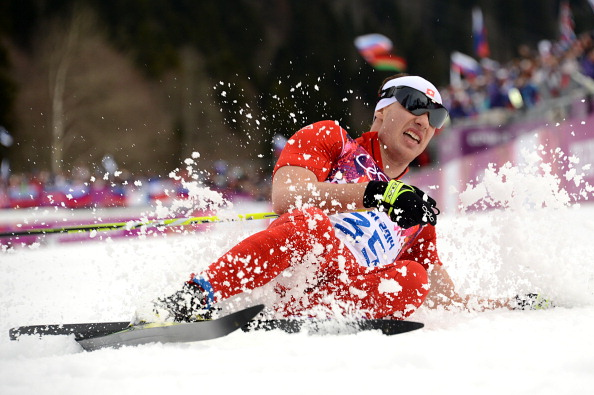 Dario Cologna slides to his second gold medal of the Games ©AFP/Getty Images