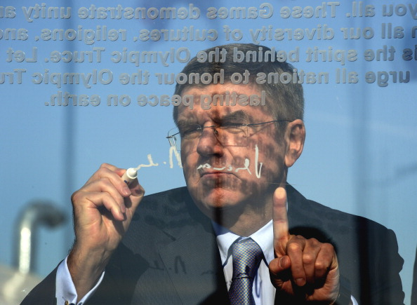 IOC President Thomas Bach writing on the Olympic Truce Wall after its unveiling this morning ©Getty Images