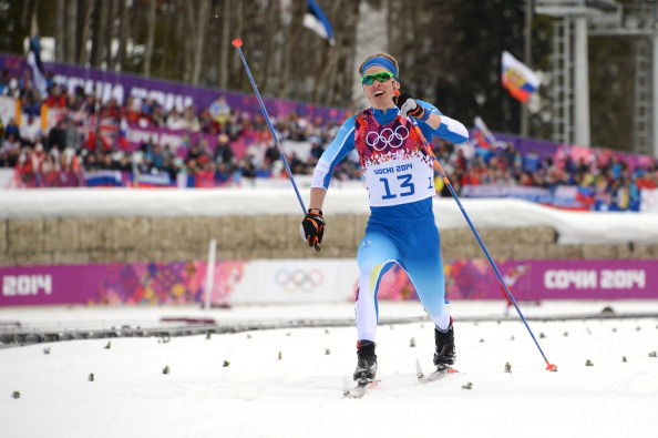 Iivo Niskanen nears collapse at the finish line of the cross country as he takes the early lead ©AFP/Getty Images