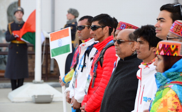 New Indian Olympic Association President Narayna Ramachandran (third from right) and athletes attended the Indian flag raising ceremony at the Mountain Olympic Village ©Getty Images