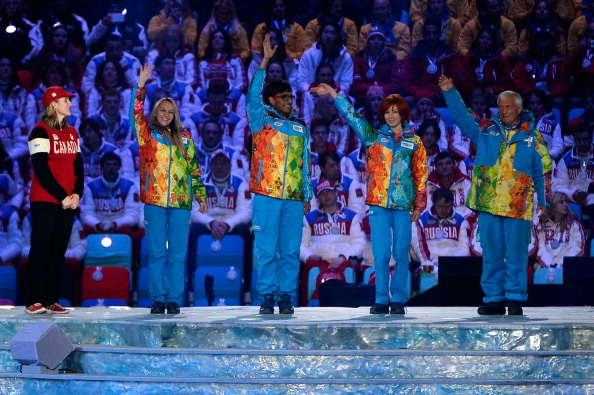 Olympic volunteer representatives wave during the 2014 Closing Ceremony watched by new IOC member Hayley Wickenheiser ©Getty Images
