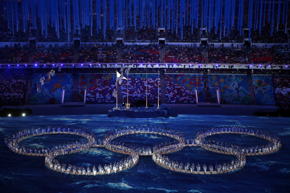 """Performers make the shape of the Olympic Rings having initially recreated the """"missing"""" Ring from the Opening Ceremony ©Getty Images"""