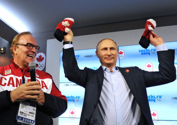 President Putin holds aloft a pair of mittens in Canada House this evening ©Getty Images