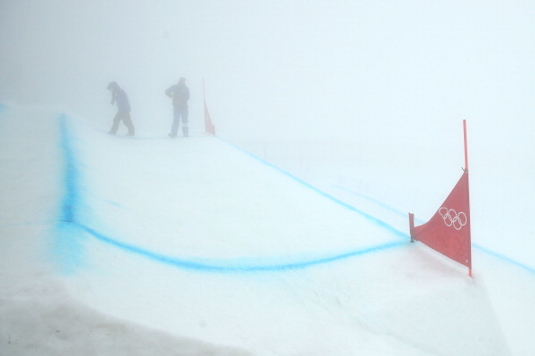 Sochi 2014 officials can be barely seen through the fog at  Rosa Khutor Extreme Park forcing organisers to postpone events ©Getty Images