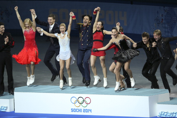 Russia leap on to the podium to collect the first ever team figure skating gold medal ©Toronto Star/Getty Images