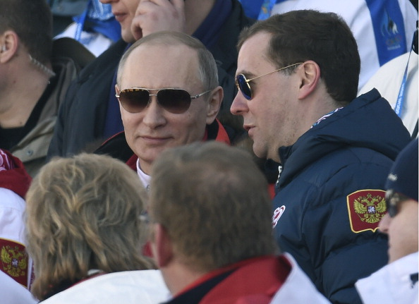 Russian President Vladimir Putin and prime minister Dmitry Medvedev watch the host nation win cross country relay silver earlier on today ©AFP/Getty Images