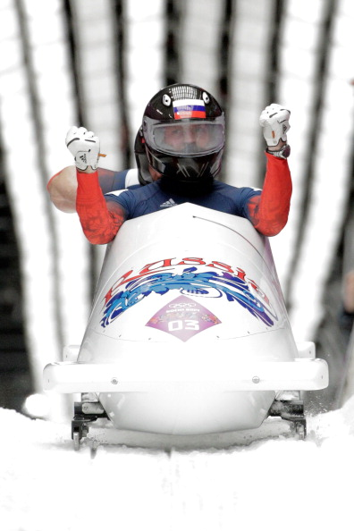 Russian flagbearer Alexander Zubkov drives the host nation to bobsleigh gold ©Getty Images
