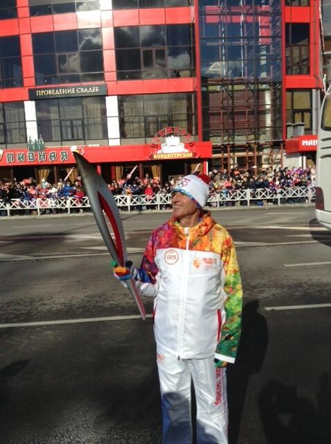 Former London 2012 chairman Sebastian Coe with the Olympic Torch in Sochi ©Twitter