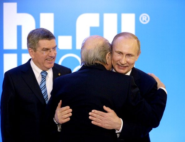 Sepp Blatter, seen here embracing Russian President Vladimir Putin watched by IOC chief Thomas Bach, does not believe anyone should be forced to step down because of their age ©Getty Images