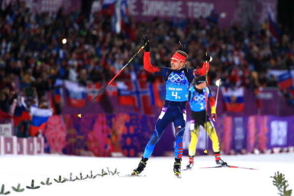 Anton Shipulin celebrates after overhauling the German team to propel Russia to a thrilling biathlon relay gold ©Getty Images