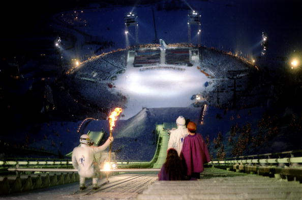 The Lillehammer 1994 Opening Ceremony's pièce de résistance came when the Olympic Torch was taken down the ski-jump by an athlete dressed in white on its way to the cauldron ©Getty Images