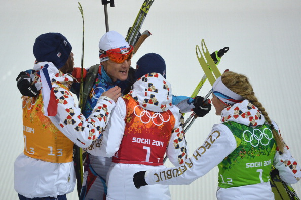 The Norwegians, including Bjoerndalen, win the first ever gold medal in mixed team biathlon ©AFP/Getty Images