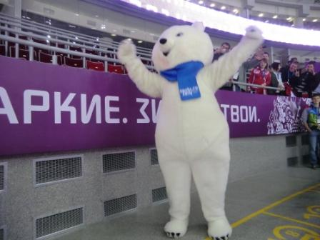The Sochi 2014 polar bear mascot enjoying plenty of attention at the ice hockey ©Philip Barker