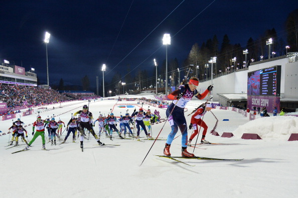 The floodlights are on and the women's biathlon mass start has begun ©AFP/Getty Images