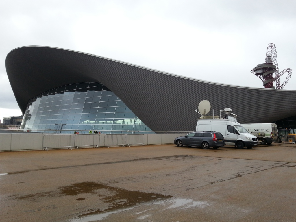 The temporary seating has been removed from the Aquatics Centre with 2,800 square metres of glass put in its place ©ITG