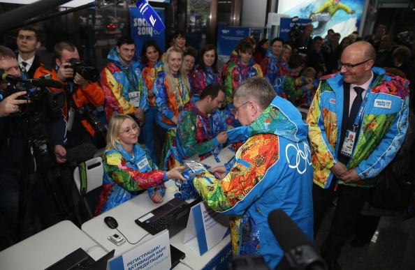 IOC President Thomas Bach officially receives his Olympic accreditation for Sochi 2014 after landing in Russia ©Getty Image