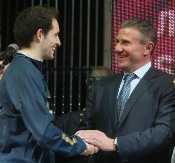 Sergey Bubka congratulates Renaud Lavillenie after seeing his world record finally bettered in his home city of Donetsk ©AFP/Getty Images