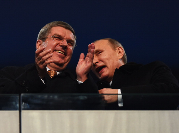 Sharing a joke perhaps? IOC President Thomas Bach and Russian President Vladimir Putin at the Opening Ceremony ©Getty Images