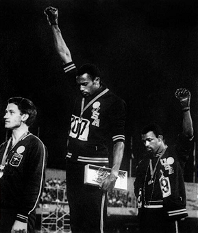 "The ""Black Power"" salute on top of the rostrum which earned 1968 Olympic 200m champion Tommie Smith, and bronze medallist John Carlos, expulsion from the US team and many years of discrimination ©AFP/ Getty Images"