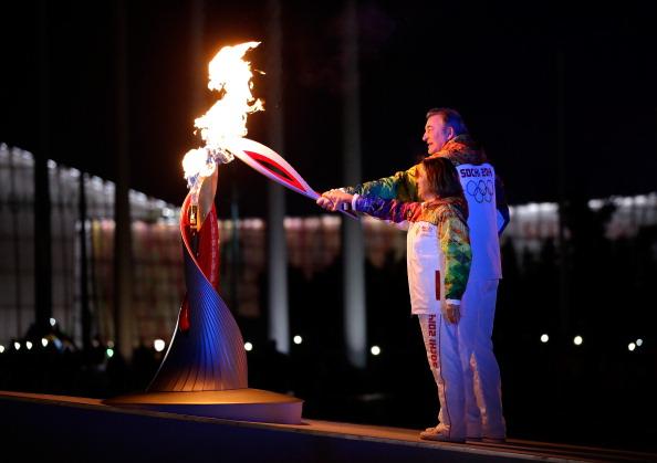 Russian icons Vladislav Tretiak and Irina Rodnina lit the Olympic cauldron ©Getty Images